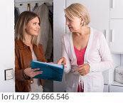 Купить «daughter shows some documents of her mother», фото № 29666546, снято 13 ноября 2017 г. (c) Яков Филимонов / Фотобанк Лори