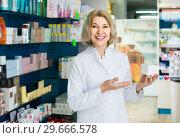 female pharmacist posing in drugstore. Стоковое фото, фотограф Яков Филимонов / Фотобанк Лори