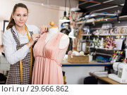 Купить «Female seamstress is thinking about new dress for collection of clothes near mannequin», фото № 29666862, снято 5 мая 2018 г. (c) Яков Филимонов / Фотобанк Лори