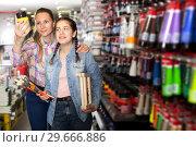 Купить «Mother and daughter holding jar with color paint», фото № 29666886, снято 12 апреля 2017 г. (c) Яков Филимонов / Фотобанк Лори