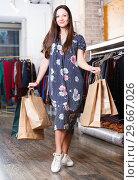 Купить «Positive cute girl customer with packs in fashion dress», фото № 29667026, снято 17 января 2018 г. (c) Яков Филимонов / Фотобанк Лори