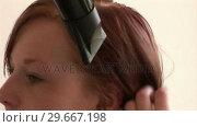 Купить «Woman Drying Hair», видеоролик № 29667198, снято 8 июля 2020 г. (c) Wavebreak Media / Фотобанк Лори