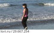 Купить «Woman Enjoying Beach Life», видеоролик № 29667254, снято 24 января 2019 г. (c) Wavebreak Media / Фотобанк Лори