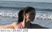 Купить «Woman Enjoying Beach Life», видеоролик № 29667258, снято 24 января 2019 г. (c) Wavebreak Media / Фотобанк Лори