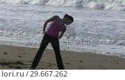 Купить «Woman Stretching on Beach», видеоролик № 29667262, снято 24 января 2019 г. (c) Wavebreak Media / Фотобанк Лори