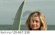 Купить «Woman with Surfboard», видеоролик № 29667338, снято 24 января 2019 г. (c) Wavebreak Media / Фотобанк Лори
