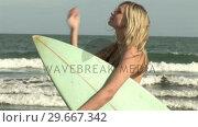 Купить «Woman with Surfboard», видеоролик № 29667342, снято 24 января 2019 г. (c) Wavebreak Media / Фотобанк Лори