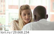 Купить «Female business woman accusing her associate of unprofessional decision», видеоролик № 29668234, снято 1 апреля 2009 г. (c) Wavebreak Media / Фотобанк Лори