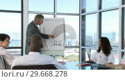 Купить «CEO in a business meeting explaining with a blackboard», видеоролик № 29668278, снято 29 марта 2009 г. (c) Wavebreak Media / Фотобанк Лори
