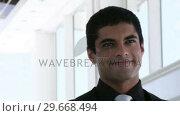 Купить «Hispanic smiling Businessman», видеоролик № 29668494, снято 31 марта 2009 г. (c) Wavebreak Media / Фотобанк Лори