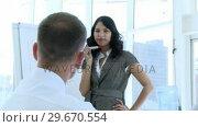 Businesswoman explaining to her colleague a new business plan. Стоковое видео, агентство Wavebreak Media / Фотобанк Лори
