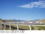 Купить «View of a high-speed train crossing a viaduct in Purroy, Zaragoza, Aragon, Spain. AVE Madrid Barcelona.», фото № 29671130, снято 1 октября 2015 г. (c) easy Fotostock / Фотобанк Лори