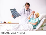 Купить «Young handsome doctor visiting female oncology patient», фото № 29671342, снято 3 октября 2018 г. (c) Elnur / Фотобанк Лори