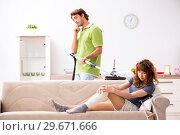 Купить «Husband helping leg injured wife in housework», фото № 29671666, снято 4 октября 2018 г. (c) Elnur / Фотобанк Лори