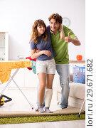 Купить «Husband helping leg injured wife in housework», фото № 29671682, снято 4 октября 2018 г. (c) Elnur / Фотобанк Лори