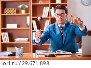 Купить «Lawyer working in the office», фото № 29671898, снято 8 августа 2018 г. (c) Elnur / Фотобанк Лори