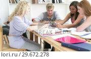 Купить «Teenagers studying Science in a library», видеоролик № 29672278, снято 22 октября 2009 г. (c) Wavebreak Media / Фотобанк Лори