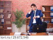 Купить «Young handsome lawyer working in his office», фото № 29672546, снято 10 сентября 2018 г. (c) Elnur / Фотобанк Лори