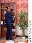 Купить «Young handsome lawyer working in his office», фото № 29672554, снято 10 сентября 2018 г. (c) Elnur / Фотобанк Лори