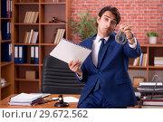 Купить «Young handsome lawyer working in his office», фото № 29672562, снято 10 сентября 2018 г. (c) Elnur / Фотобанк Лори