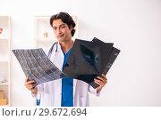 Купить «Young male doctor radiologist working at the clinic», фото № 29672694, снято 5 ноября 2018 г. (c) Elnur / Фотобанк Лори