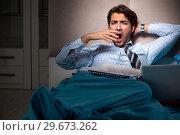Купить «Tired businessman working overtime at home at night», фото № 29673262, снято 18 сентября 2018 г. (c) Elnur / Фотобанк Лори
