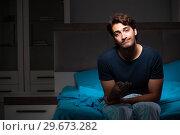 Купить «Man watching tv at night in bed», фото № 29673282, снято 18 сентября 2018 г. (c) Elnur / Фотобанк Лори