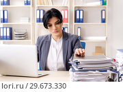 Купить «Middle aged businesslady unhappy with excessive work», фото № 29673330, снято 15 ноября 2018 г. (c) Elnur / Фотобанк Лори