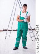 Купить «Young contractor in house renovation concept», фото № 29674294, снято 17 октября 2018 г. (c) Elnur / Фотобанк Лори