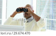Купить «Ethnic businessman looking through binoculars», видеоролик № 29674470, снято 10 декабря 2019 г. (c) Wavebreak Media / Фотобанк Лори
