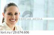 Купить «Portrait of a smiling caucasian businesswoman», видеоролик № 29674606, снято 21 февраля 2019 г. (c) Wavebreak Media / Фотобанк Лори