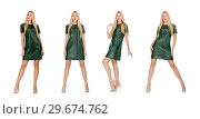 Купить «Young woman in green dress isolated on white», фото № 29674762, снято 22 сентября 2014 г. (c) Elnur / Фотобанк Лори