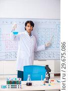 Купить «Young chemist working in the lab», фото № 29675086, снято 19 октября 2018 г. (c) Elnur / Фотобанк Лори