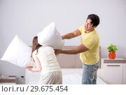 Купить «Wife and husband having pillow fight in bedroom», фото № 29675454, снято 27 июня 2018 г. (c) Elnur / Фотобанк Лори