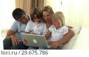 Купить «United family surfing on the internet », видеоролик № 29675786, снято 24 марта 2019 г. (c) Wavebreak Media / Фотобанк Лори