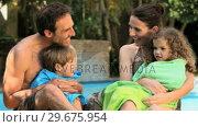 Купить «Family laughing after pool», видеоролик № 29675954, снято 7 ноября 2010 г. (c) Wavebreak Media / Фотобанк Лори