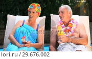 Купить «Old couple relaxing near the pool.», видеоролик № 29676002, снято 7 ноября 2010 г. (c) Wavebreak Media / Фотобанк Лори