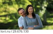 Купить «Man hugging his wife», видеоролик № 29676130, снято 10 ноября 2010 г. (c) Wavebreak Media / Фотобанк Лори