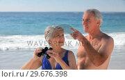 Купить «Elderly couple looking through binoculars», видеоролик № 29676398, снято 14 ноября 2010 г. (c) Wavebreak Media / Фотобанк Лори