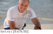 Elderly man posing in front of the camera with a bike. Стоковое видео, агентство Wavebreak Media / Фотобанк Лори