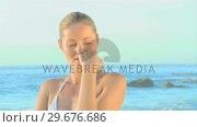 Купить «Attractive blonde woman on a beach», видеоролик № 29676686, снято 15 ноября 2010 г. (c) Wavebreak Media / Фотобанк Лори