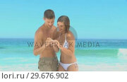 Sweet couple having fun with a camera. Стоковое видео, агентство Wavebreak Media / Фотобанк Лори