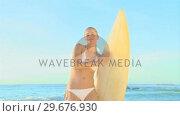 Купить «Attractive young girl posing with a surfboard», видеоролик № 29676930, снято 15 ноября 2010 г. (c) Wavebreak Media / Фотобанк Лори