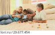Купить «Couple playing with baby on carpet», видеоролик № 29677454, снято 6 ноября 2010 г. (c) Wavebreak Media / Фотобанк Лори