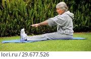 Купить «Mature woman stretching», видеоролик № 29677526, снято 6 ноября 2010 г. (c) Wavebreak Media / Фотобанк Лори