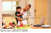 Купить «Mother coping with baby while cooking and using a laptop», видеоролик № 29677654, снято 6 ноября 2010 г. (c) Wavebreak Media / Фотобанк Лори