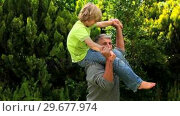Купить «Man carrying his son on his shoulders in the garden», видеоролик № 29677974, снято 6 ноября 2010 г. (c) Wavebreak Media / Фотобанк Лори