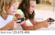 Купить «Children playing video games», видеоролик № 29678486, снято 2 ноября 2011 г. (c) Wavebreak Media / Фотобанк Лори