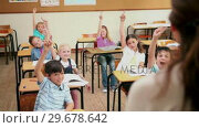 Купить «Teacher choosing a pupil», видеоролик № 29678642, снято 5 ноября 2011 г. (c) Wavebreak Media / Фотобанк Лори