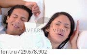 Купить «Woman can not sleep because of her snoring husband», видеоролик № 29678902, снято 3 ноября 2011 г. (c) Wavebreak Media / Фотобанк Лори